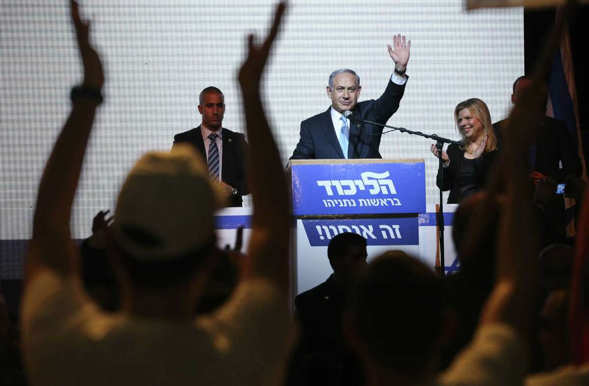 In this March 17 file photo, Israeli Prime Minister Benjamin Netanyahu greets supporters at the party's election headquarters in Tel Aviv, Israel.