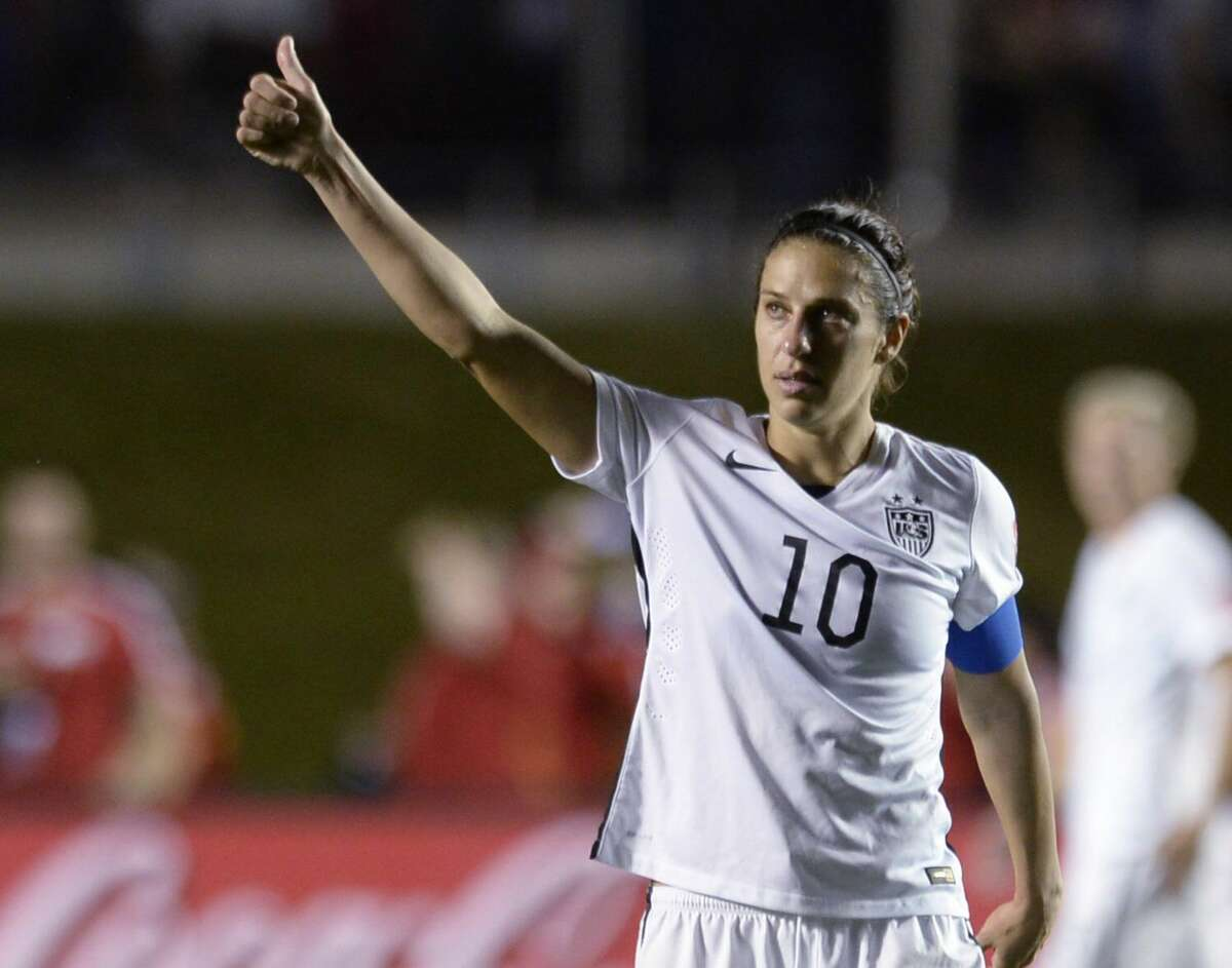 United States' Carli Lloyd (10) looks toward fans after the United States defeated China 1-0 in a quarterfinal match in the FIFA Women's World Cup.