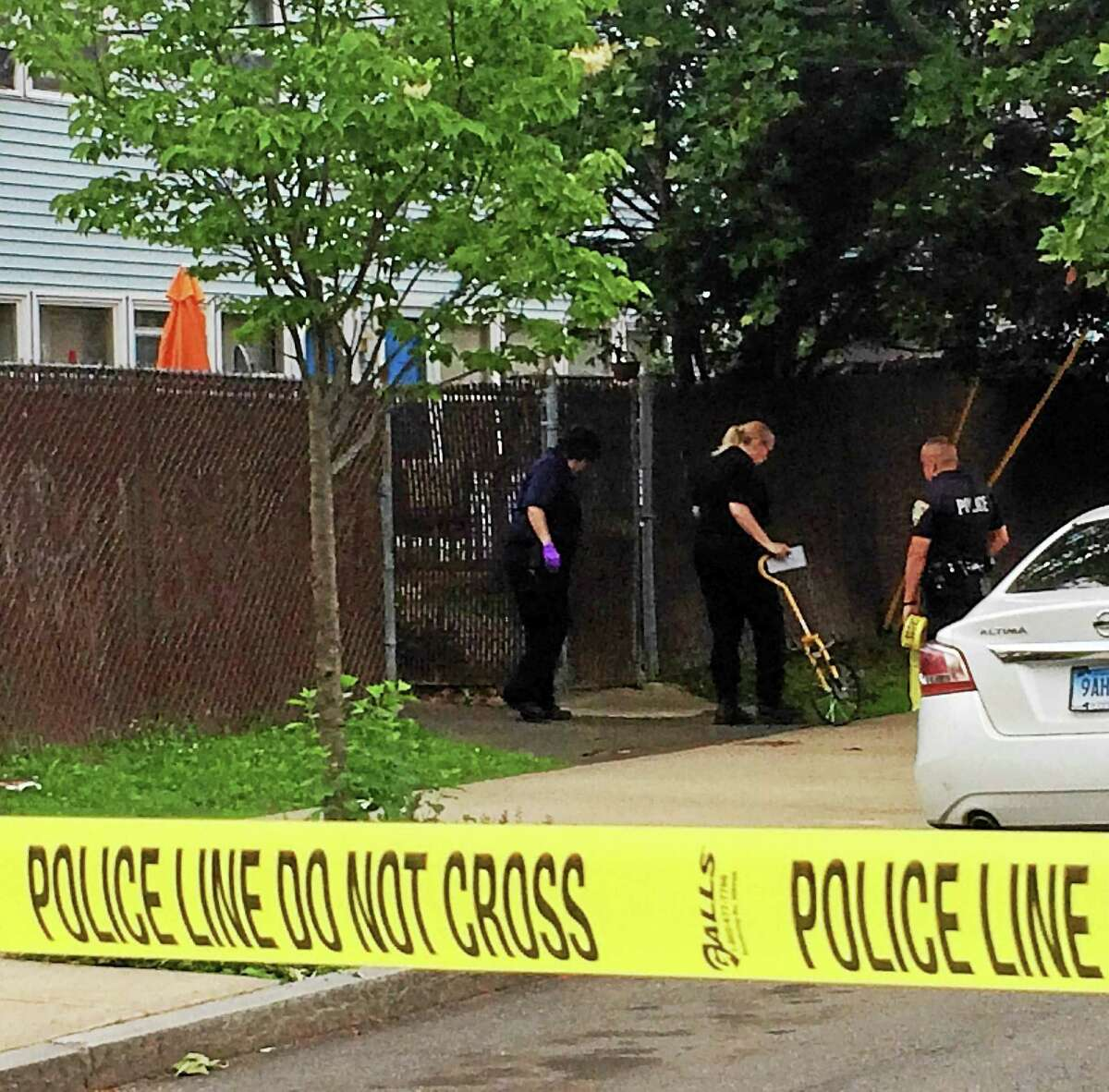 Police investigate a fatal shooting that happened early Friday near Putnam and Liberty streets in New Haven.
