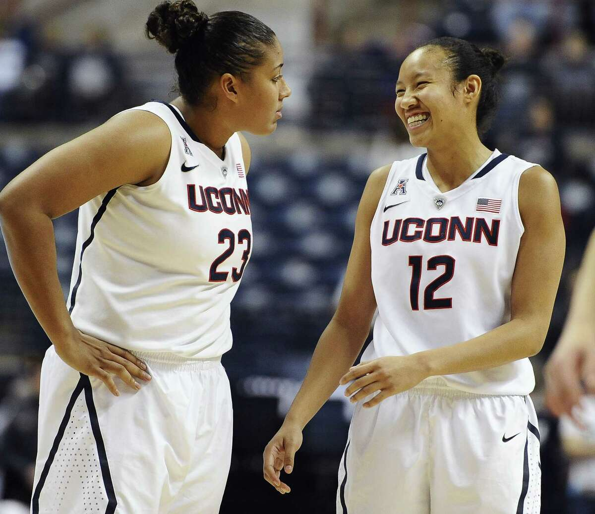 UConn's Kaleena Mosqueda-Lewis, left, and Saniya Chong share a light moment as they wait for teammate Kia Nurse to shoot a free throw during a 92-58 win over Temple on Jan. 14 in Storrs.