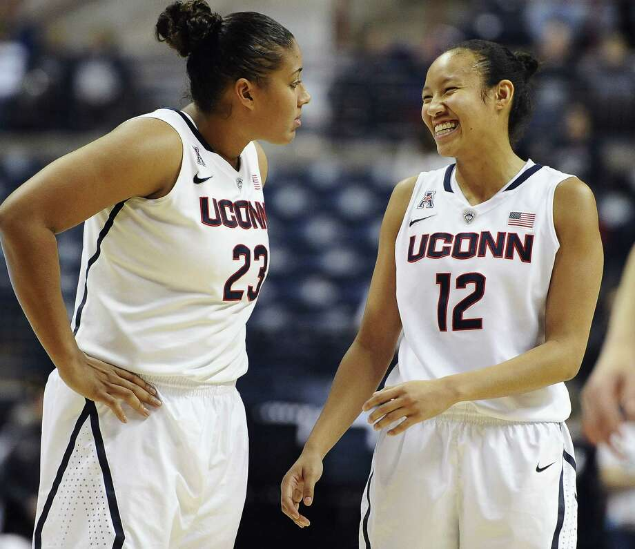 UConn's Kaleena Mosqueda-Lewis, left, and Saniya Chong share a light moment as they wait for teammate Kia Nurse to shoot a free throw during a 92-58 win over Temple on Jan. 14 in Storrs. Photo: Jessica Hill — The Associated Press   / FR125654 AP