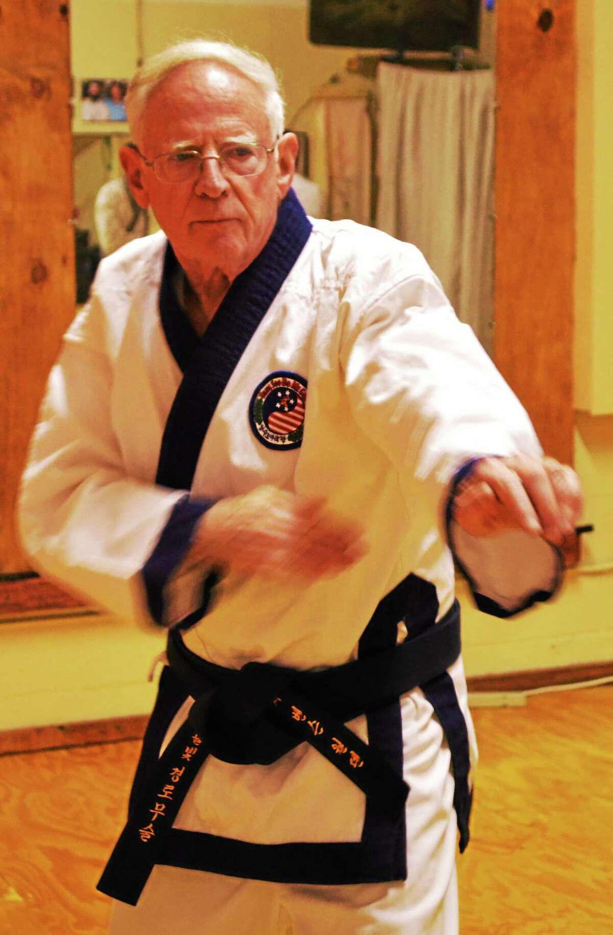 George Benson Werthan practices a Tang Soo Do move at Moonlit Path Martial Arts in Branford.
