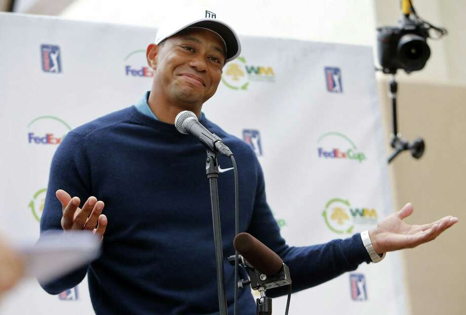 Tiger Woods gestures as he talks to the media after playing a practice round at the Phoenix Open Tuesday in Scottsdale, Ariz. Photo: Rick Scuteri — The Associated Press   / FR157181 AP