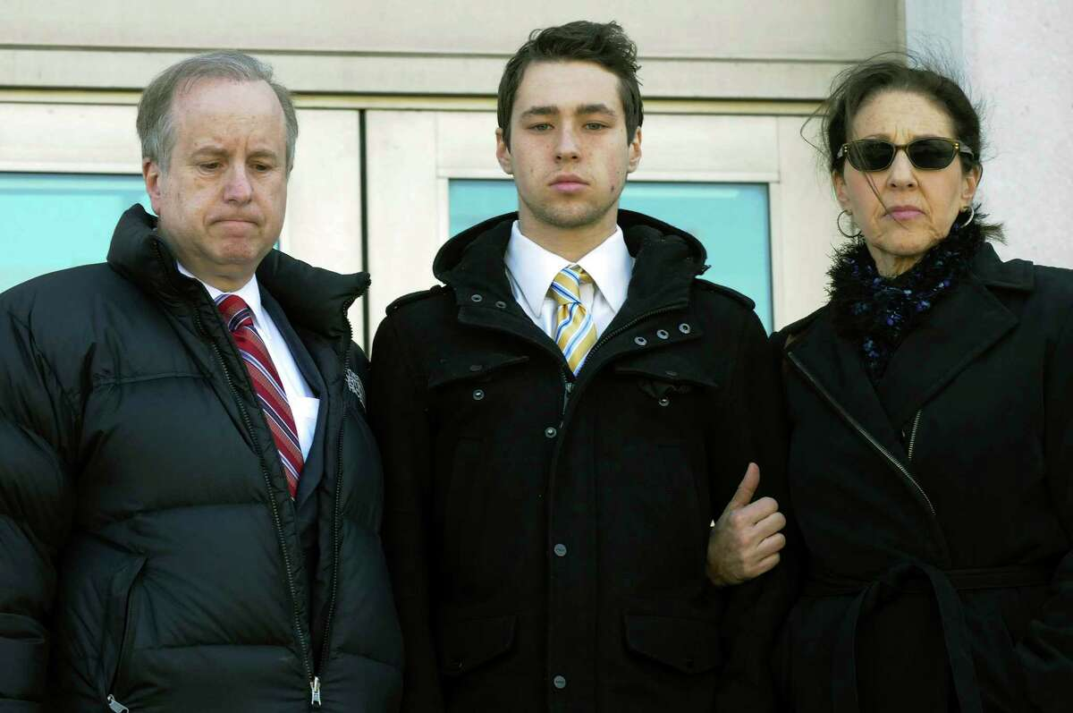 Wesleyan University sophomore Zachary Kramer, 21, of Bethesda, Md., leaves Middletown, Conn., Superior Court with his parents on Wednesday, Feb. 25, 2015, after his arraignment for possession of controlled substances and other charges. He is one of four students arrested after a rash of illnesses on campus linked to the party drug Molly.