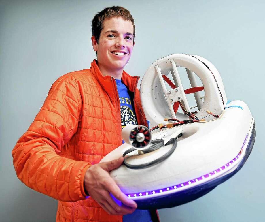 Matt Sheehy of Wakefield, Rhode Island, is photographed April 24 with his ninth generation hovercraft at the University of New Haven Orange Campus. Sheehy has been awarded the first Kaufman Scholarship for four years of study at the University of New Haven's Tagliatela College of Engineering. Photo: Arnold Gold — New Haven Register