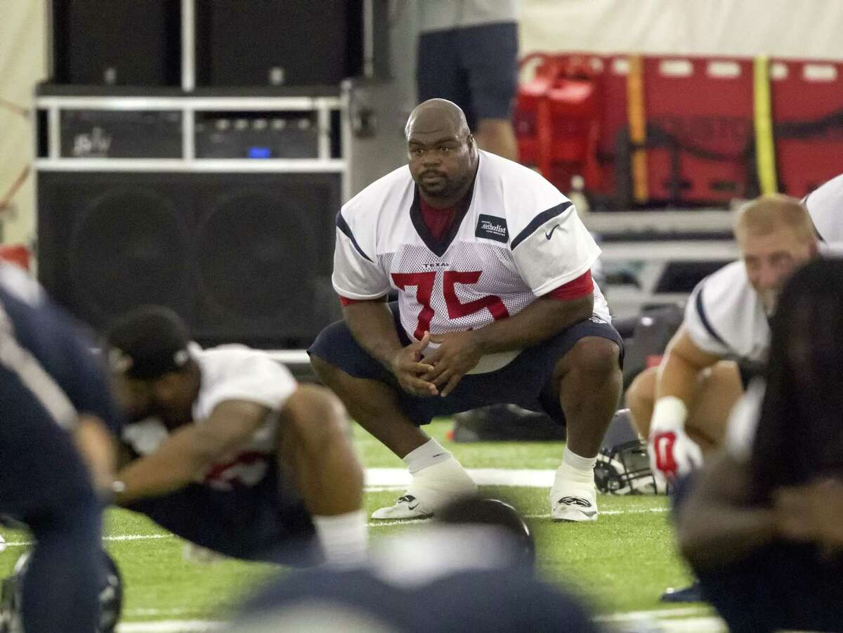 Texans nose tackle Vince Wilfork (75) works out during an organized team activity on Wednesday in Houston.