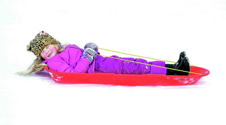 (Arnold Gold-New Haven Register)  Cecilia Wilcox, 5, of Milford closes her eyes as she sleds down a hill in Milford on 1/27/2015. Photo: Journal Register Co.