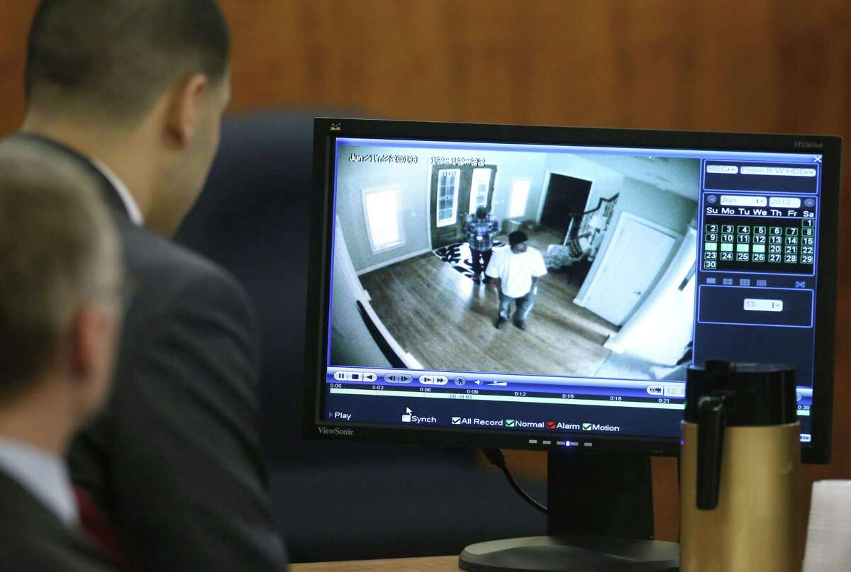 Aaron Hernandez, top left, sits with his defense attorney Charles Rankin, left, as surveillance video from June 17, 2013 is displayed on a monitor during his murder trial Thursday in Fall River, Mass.