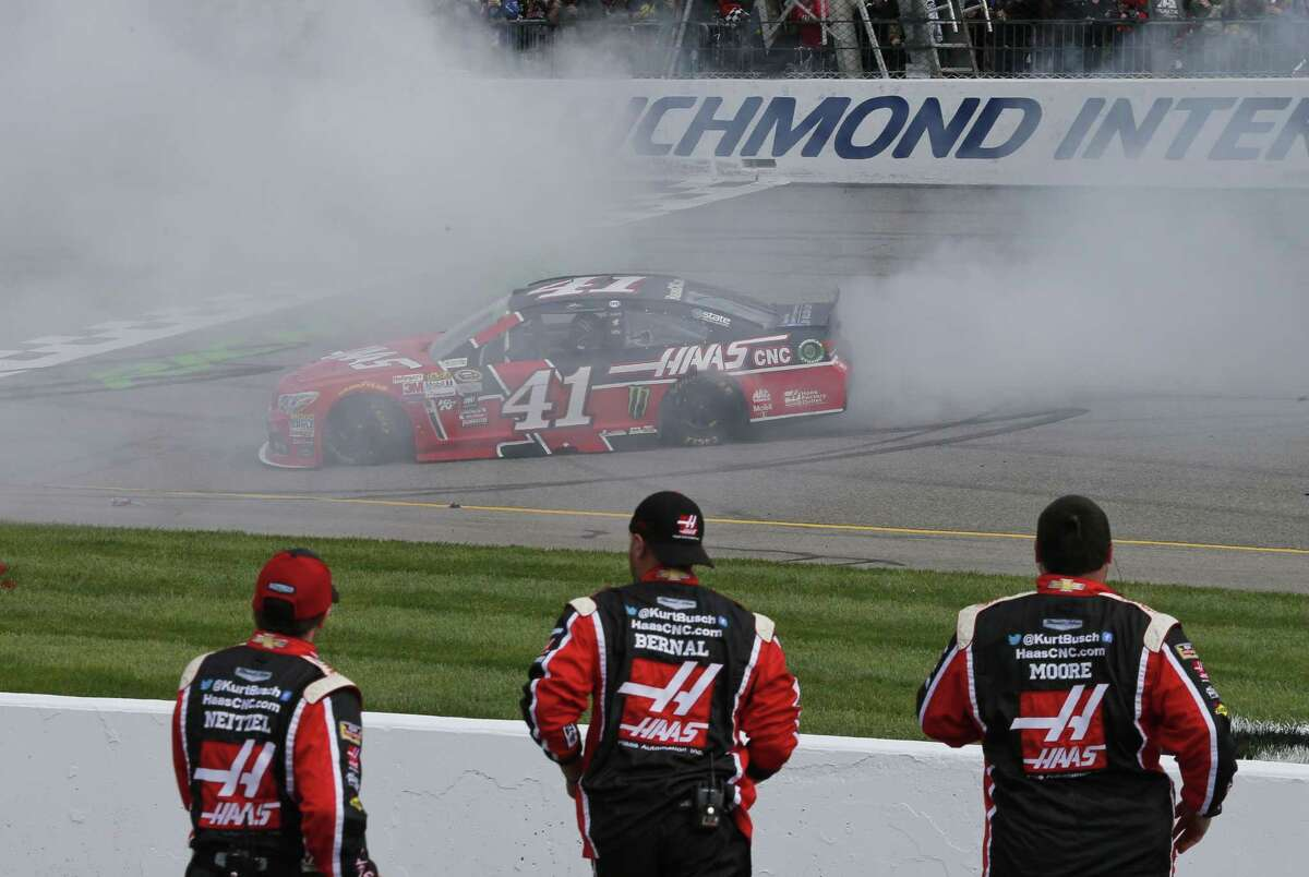 Kurt Busch does a burnout as he celebrates after winning at Richmond International Raceway on Sunday.