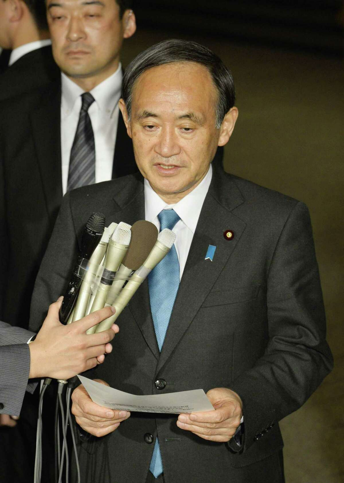 """Japanese government spokesman Chief Cabinet Secretary Yoshihide Suga speaks to the media at the prime minister's office in Tokyo on Jan. 28, 2015 shortly after the latest online message purportedly from the Islamic State group warmed that Japanese hostage Kenji Goto and a Jordanian pilot the extremists hold have less than """"24 hours left to live."""""""