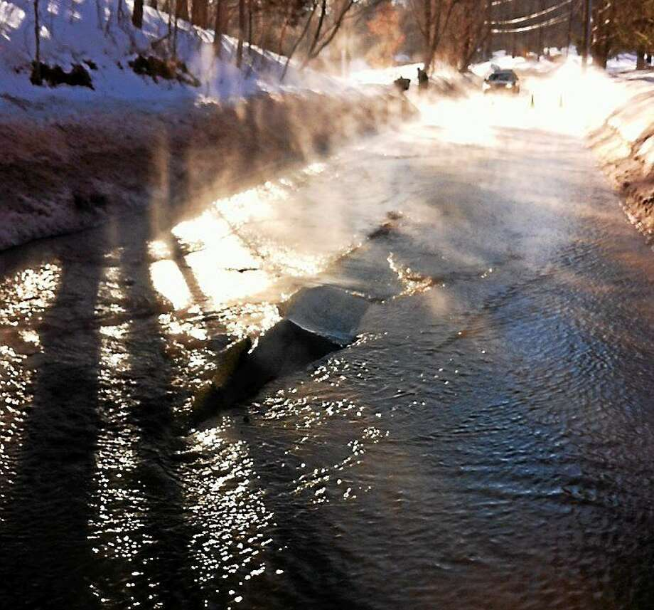 A water main break shut down South Brooksvale Road in Cheshire at the height of the morning rush hour Tuesday. Police said it could be closed for several hours. Photo: (Photo Courtesy Of The Cheshire Police Department)