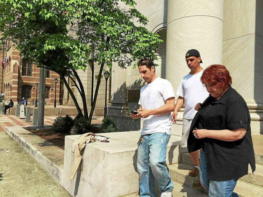 Frank Biancur Jr., center, with hat, leaves court Wednesday. Photo: Esteban Hernandez — New Haven Register