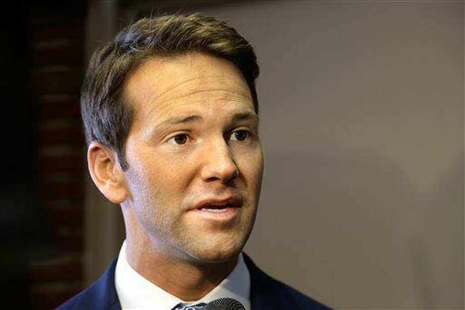 U.S. Rep. Aaron Schock speaks to reporters before meetings with constituents after a week in which he faced twin scandals Friday, Feb. 6, 2015, in Peoria Ill. A watchdog group has demanded a congressional ethics probe into how the central Illinois Republican paid for an elaborate, Downton Abbey-like design of his Washington office, and his communications director resigned after making racist comments on his Facebook page. (AP Photo/Seth Perlman) Photo: AP / AP
