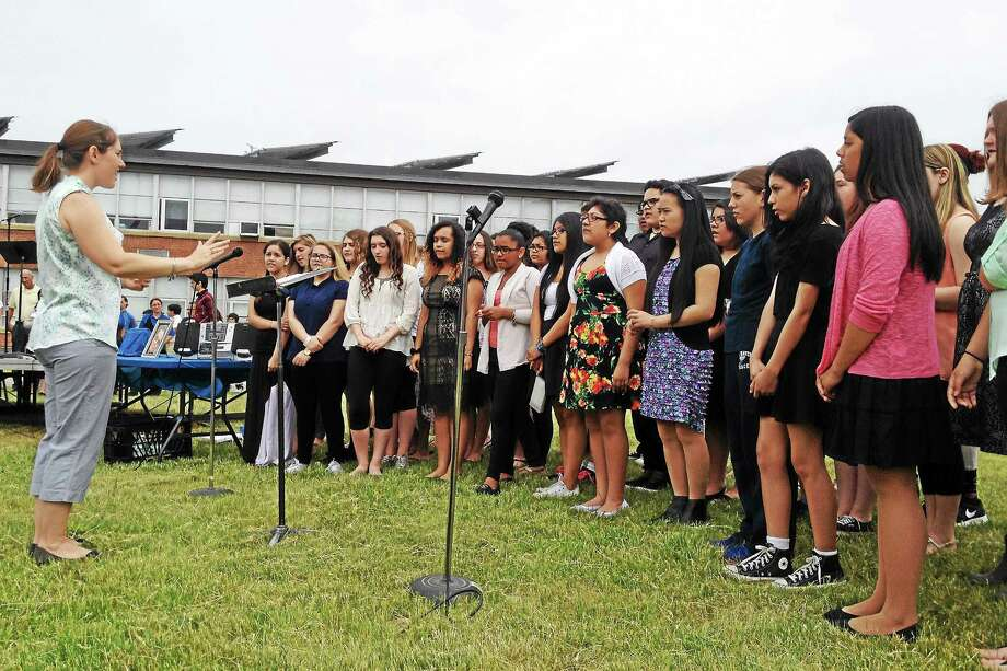 "Led by choir director Dawn Emerman, the Joseph Melillo Middle School concert choir performs Eric Clapton's ""Tears in Heaven"" during a memorial ceremony for Gerald ""Jerry"" Consiglio, who died last fall after working several years as a security guard at the school. Photo: Esteban L. Hernandez — New Haven Register"