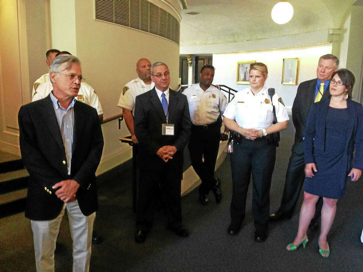 Dr. Steven Marans, psychoanalyst with Yale Child Study is far left, William Carbone is center. More than 30 police chiefs from around the country came to New Haven this week to talk about new strategies for changing behavior of youth offenders.