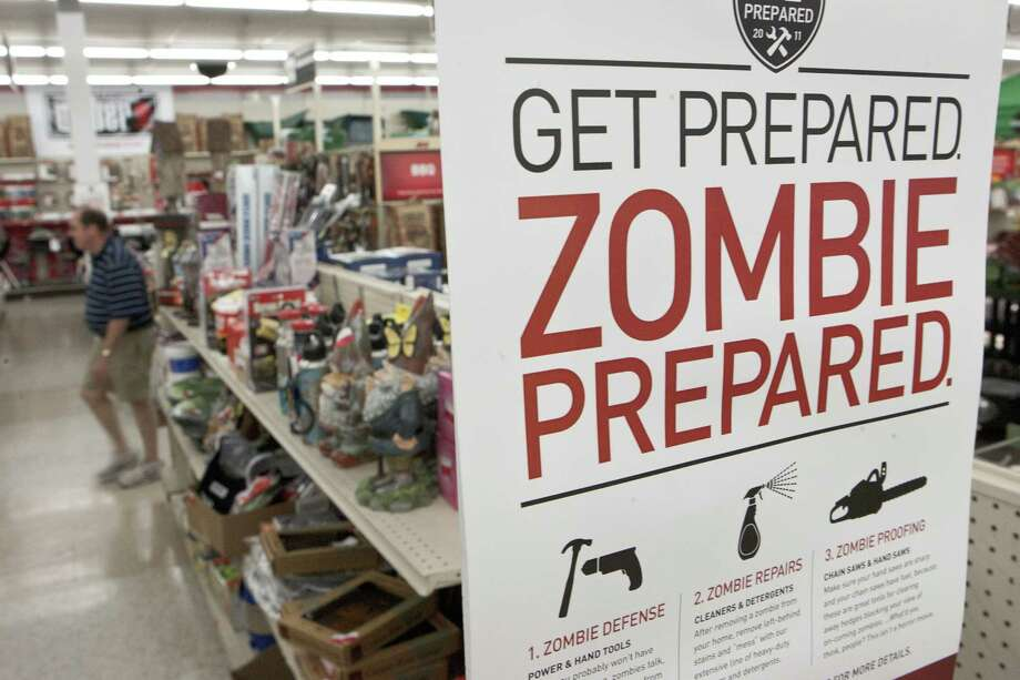 In this Oct. 10, 2011, file photo, a sign promoting zombie preparedness displays in a hardware store in Omaha, Neb. Photo: AP File Photo