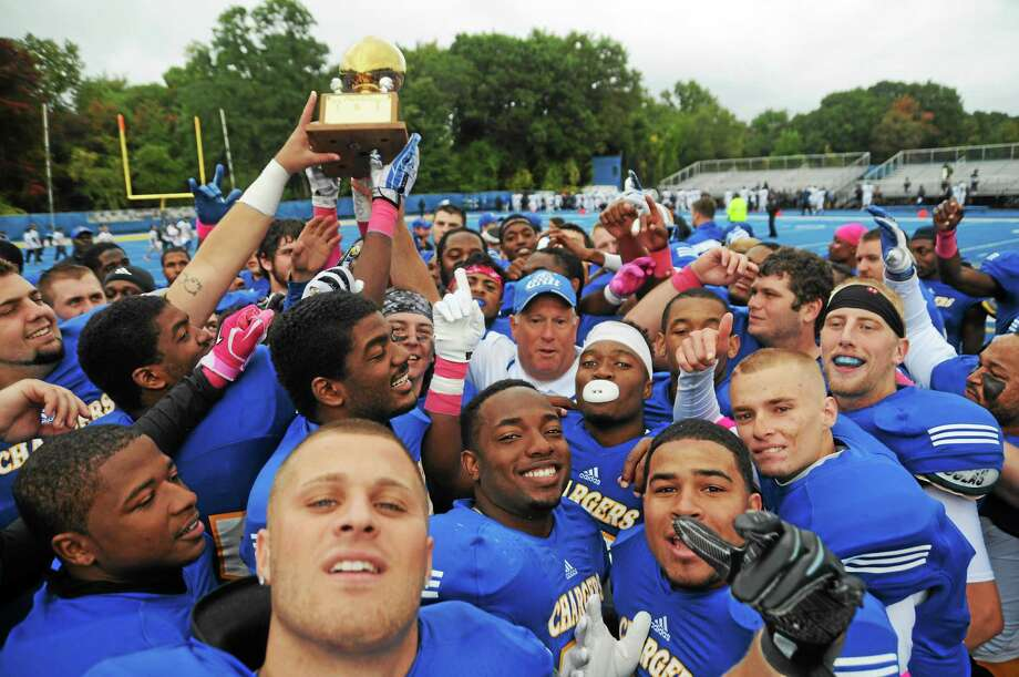 New Haven celebrates after defeating Southern Connecticut State 27-14 for the Elm City Trophy on Oct. 11, 2014. Photo: Register File Photo