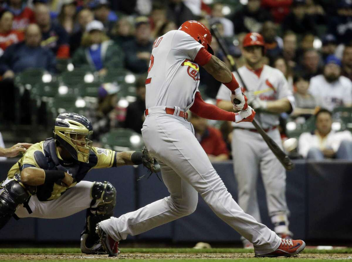 The St. Louis Cardinals' Jason Heyward hits a home run during Friday night's win over the Brewers in Milwaukee.
