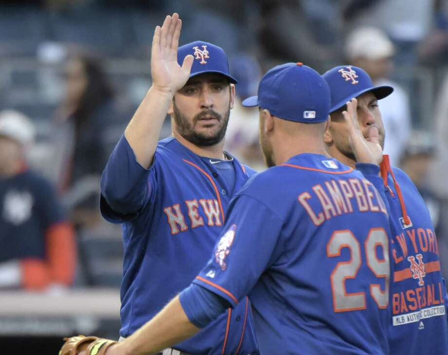 New York Mets starter Matt Harvey celebrates with Eric Campbell after the Mets defeated the Yankees 8-2 in on Saturday at Yankee Stadium. Photo: Bill Kostroun — The Associated Press   / FR51951 AP
