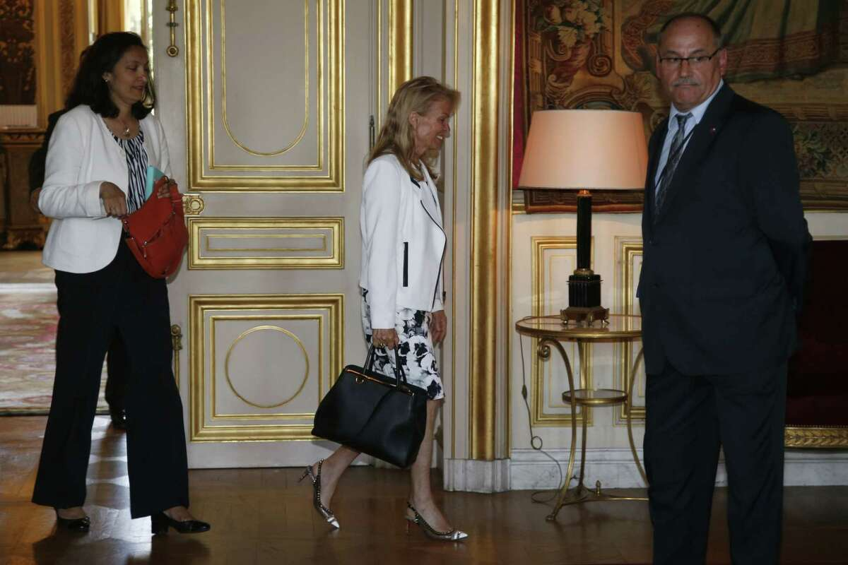 U.S. Ambassador Jane Hartley, center, walks out of the office of French Foreign Affairs Minister Laurent Fabius after a meeting at Quai d'Orsay Foreign Affairs ministry in Paris Wednesday June 24, 2015. The US ambassador to France was called in to the French Foreign Ministry Wednesday to answer questions about revelations that the US National Security Agency spied on top French authorities, actions French President Francois Hollande decried as