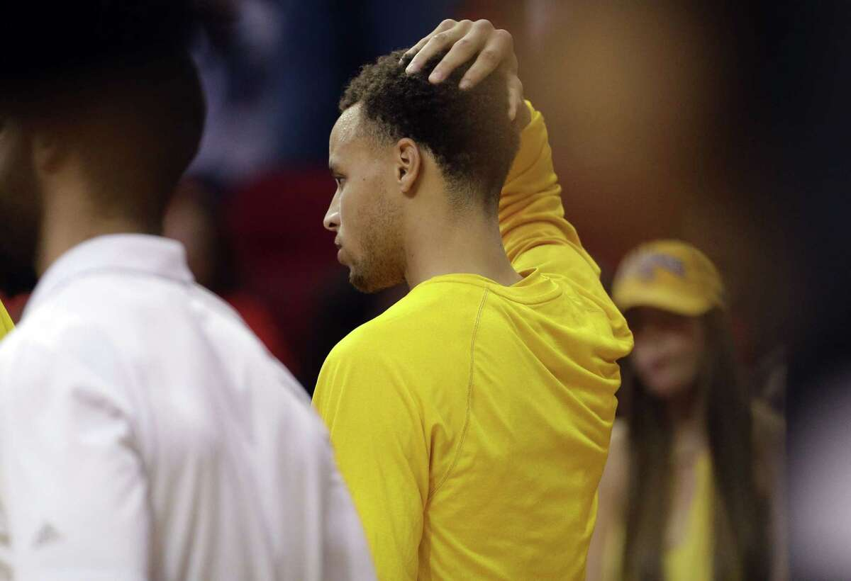 Golden State Warriors guard Stephen Curry (30) returns to the game, after being injured in a fall earlier, during the second half in Game 4 of the NBA basketball Western Conference finals against the Houston Rockets, Monday, May 25, 2015, in Houston. (AP Photo/David J. Phillip)