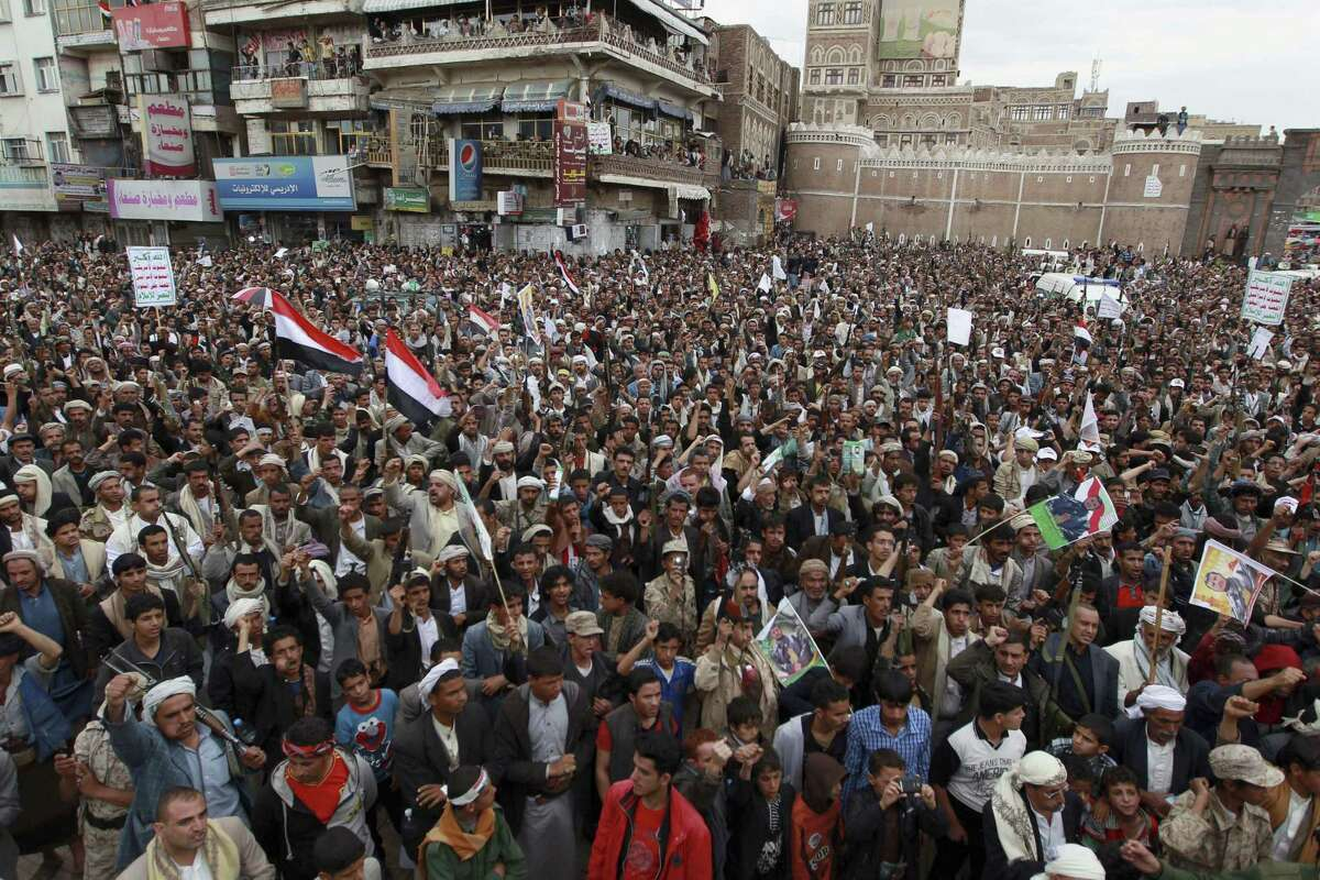 Shiite rebels, known as Houthis, gather to protest against Saudi-led airstrikes, during a rally in Sanaa, Yemen, Thursday. Saudi Arabia bombed key military installations in Yemen, and Yemen's fleeing president has taken refuge in Saudi Arabia.
