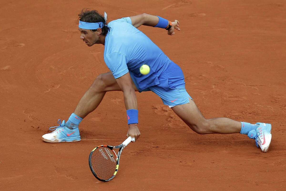 Rafael Nadal returns to Quentin Halys during their first-round match on Tuesday at the French Open in Paris.