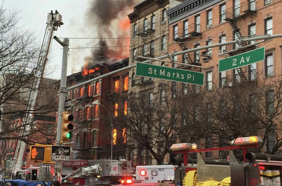 New York City firefighters work the scene of a large fire and a partial building collapse in the East Village neighborhood of New York Thursday. Photo: Associated Press   / AP