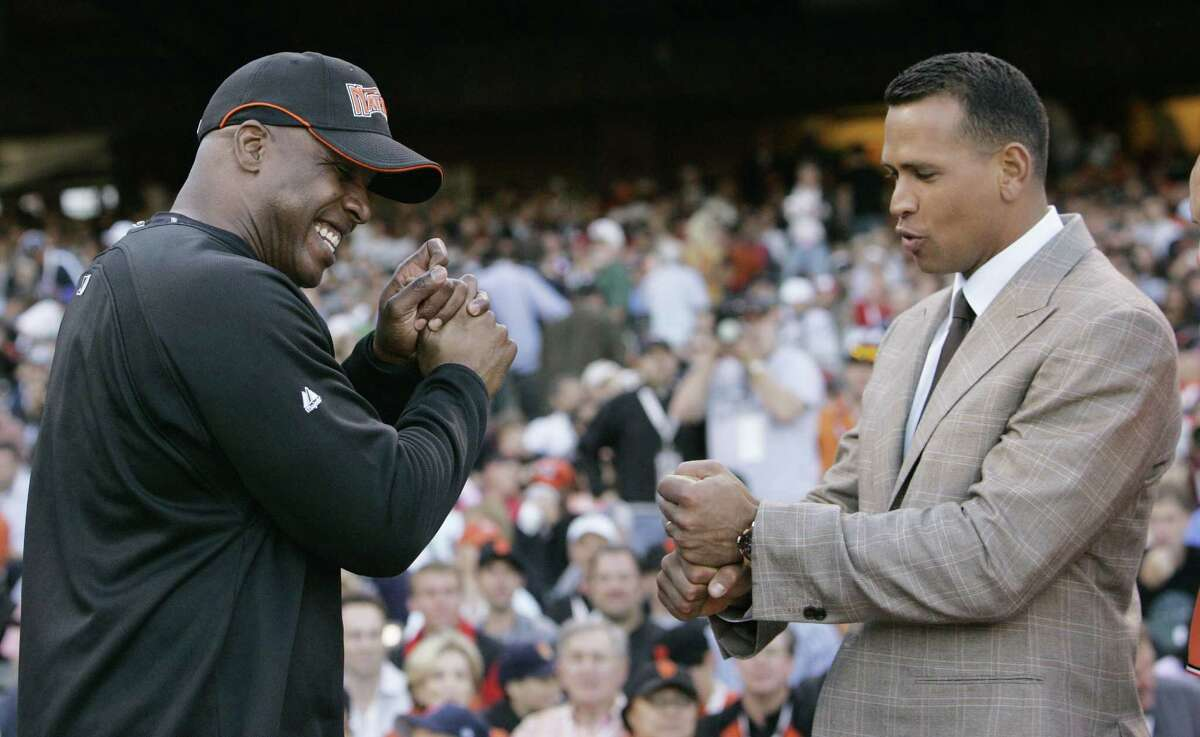 In this July 9, 2007 file photo, the New York Yankees' Alex Rodriguez, right, talks to the Giants' Barry Bonds during the home run derby in San Francisco.