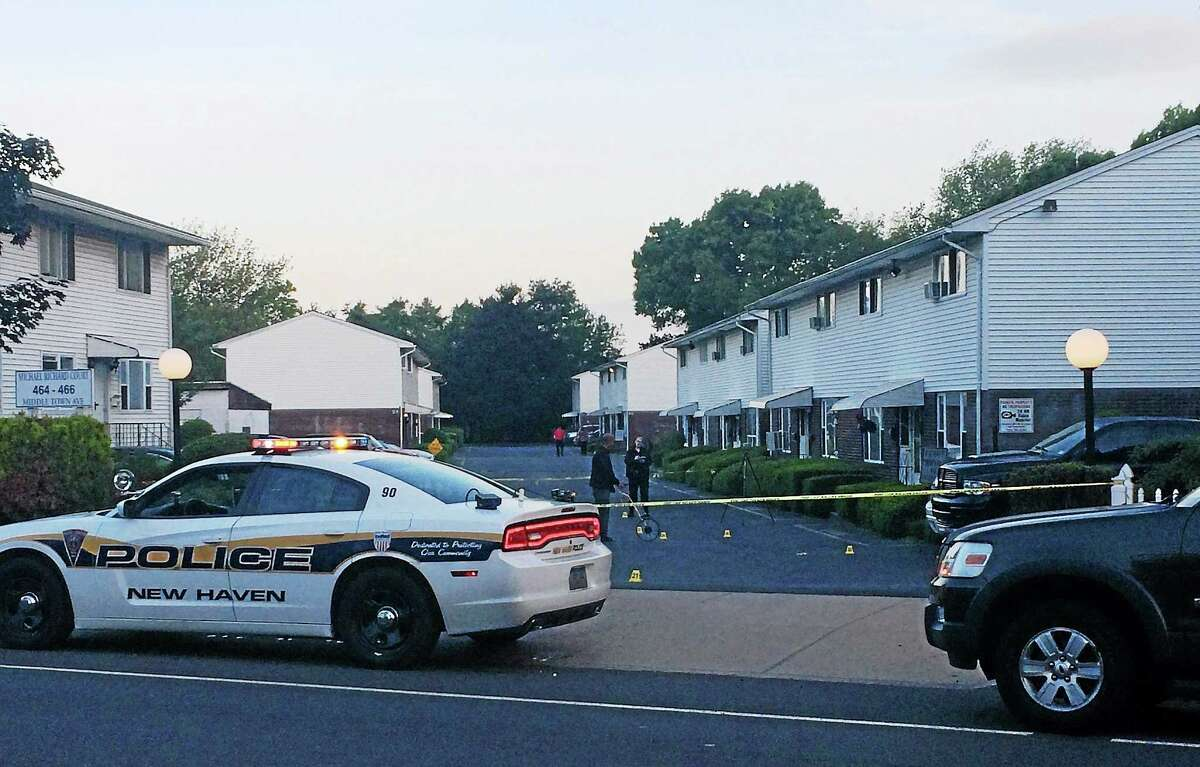New Haven police worked for hours early Tuesday to gather evidence around an apartment complex on Middletown Avenue after dozens of gunshots reportedly rang out there early Tuesday.