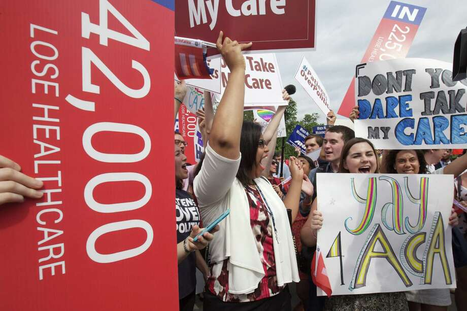 """Jessica Ellis, right, with """"yay 4 ACA"""" sign, and other supporters of the Affordable Care Act, react with cheers as the opinion for health care is reported outside of the Supreme Court in Washington,Thursday June 25, 2015. The Supreme Court on Thursday upheld the nationwide tax subsidies under President Barack Obama's health care overhaul, in a ruling that preserves health insurance for millions of Americans.  (AP Photo/Jacquelyn Martin) Photo: AP / AP"""