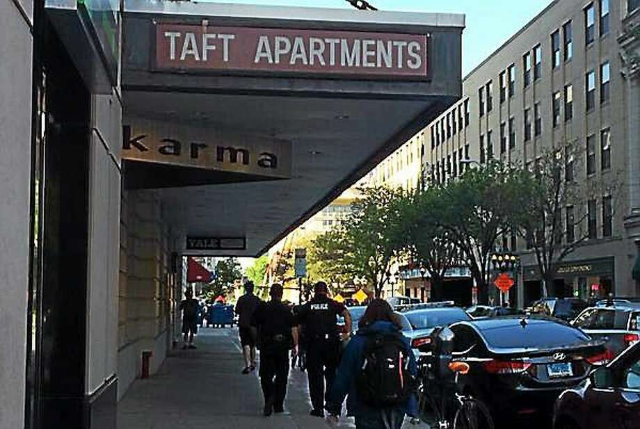 Wes Duplantier — New Haven Register  Police were on scene Tuesday morning to investigate an incident at the Taft Apartments. A man reportedly stabbed an acquaintance and then jumped from a ninth-floor apartment and died. Photo: Journal Register Co.