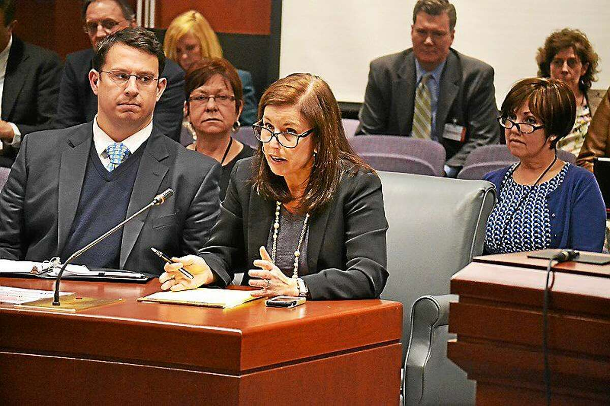 Milford Mayor Ben Blake and state Sen. Gayle Slossberg, D-Milford, testify at a public hearing in Hartford about a bill to get some of the Silver Sands property back from the state.