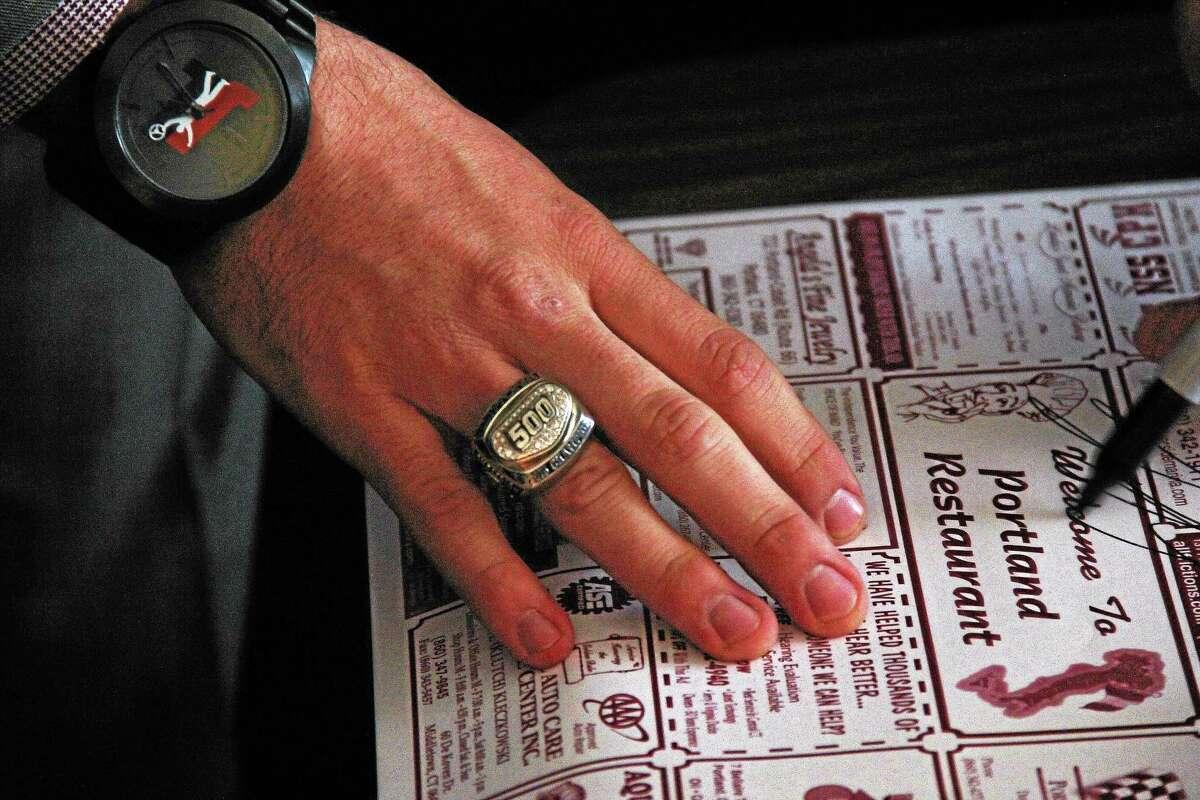 Joey Logano wears a Daytona 500 ring as he signs an autographs for a fan in Portland.