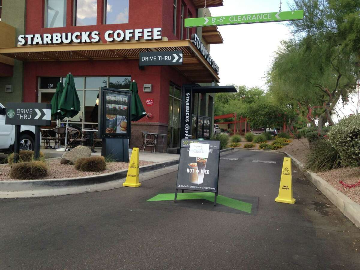 A Starbucks store closes Friday, April 24, 2015, in Phoenix because of computer issues. Starbucks says a sales register computer glitch has disrupted sales at company-operated stores in the United States and Canada. The company apologized to customers for the inconvenience late Friday and said it was working to resolve the outage. Customers found some stores closed and others offering free coffee. (AP Photo/Traci Carl)