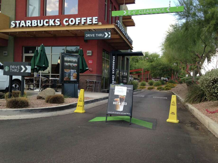 A Starbucks store closes Friday, April 24, 2015, in Phoenix because of computer issues. Starbucks says a sales register computer glitch has disrupted sales at company-operated stores in the United States and Canada.  The company apologized to customers for the inconvenience late Friday and said it was working to resolve the outage. Customers found some stores closed and others offering free coffee. (AP Photo/Traci Carl) Photo: AP / AP