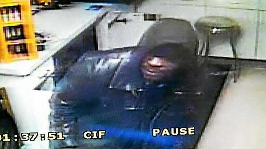 Police say two men robbed the Mobile gas station on Saybrook Road in Haddam on Sunday, making off with cigarettes. Photo: Courtesy Haddam Resident State Trooper