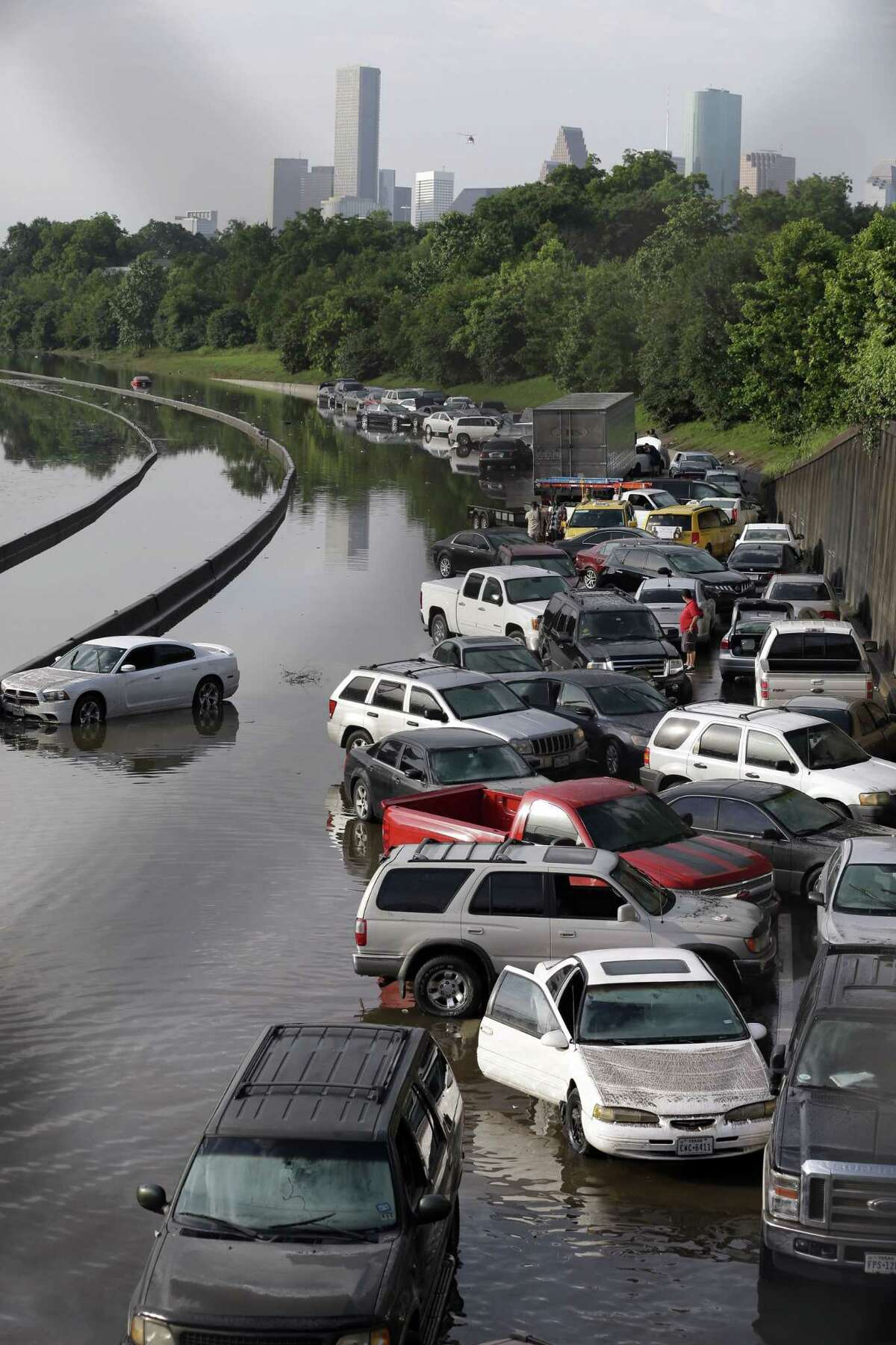 Cars remain stranded along a flooded section of Interstate 45 after heavy rains overnight in Houston Tuesday. Several major highways are closed in the Houston area due to high water.