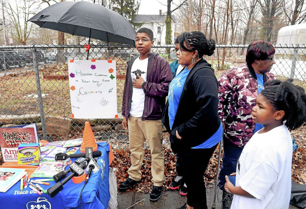 Isaiah Rutherford, center, 17, speaks during a memorial for TeLea Turnage near Lincoln Bassett School in New Haven Thursday.