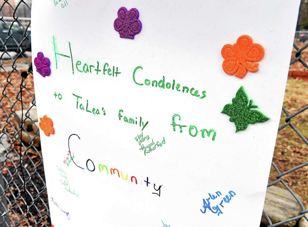 A condolence poster for TeLea Turnage hangs near Lincoln Bassett School in New Haven.
