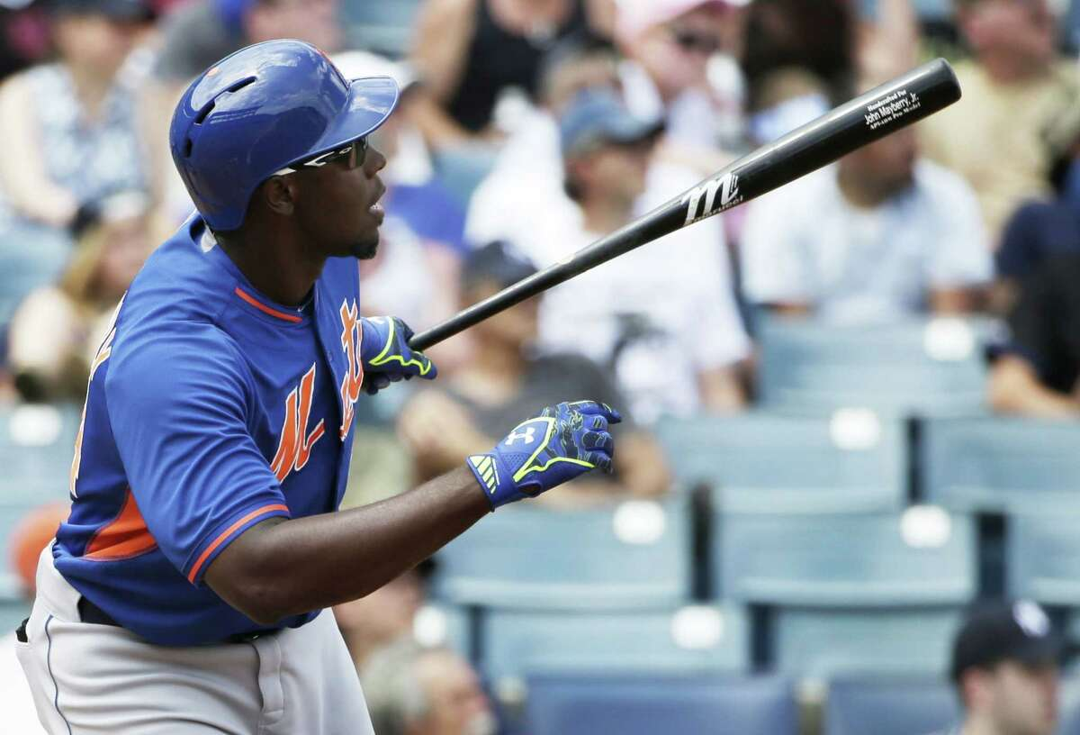 The New York Mets' John Mayberry Jr. watches his solo home run off New York Yankees starter Masahiro Tanaka in the fourth inning of Wednesday's spring training game in Tampa, Fla.