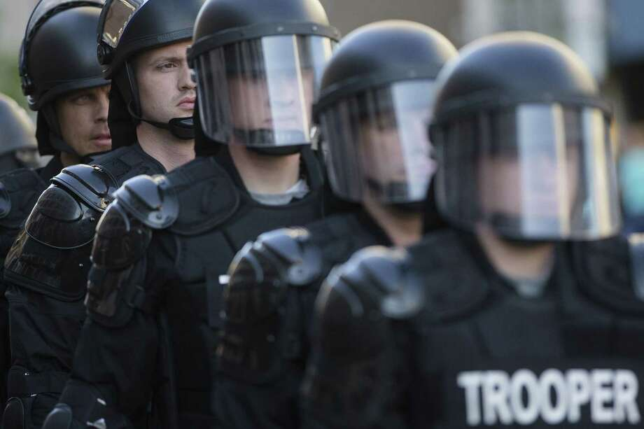 In this May 23, 2015 photo, riot police stand in formation as a protest forms against the acquittal of Michael Brelo, a patrolman charged in the shooting deaths of two unarmed suspects in Cleveland. Photo: AP Photo/John Minchillo, File   / AP