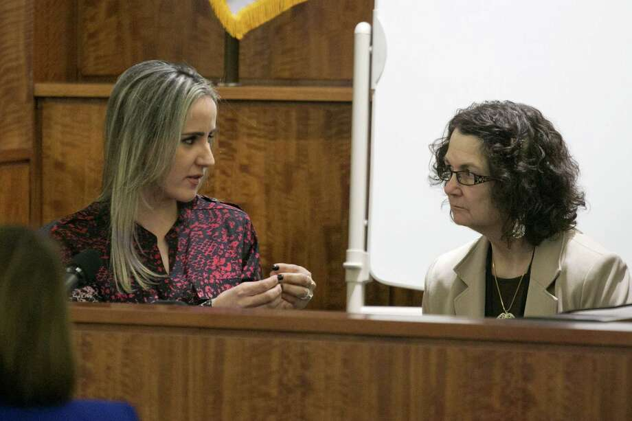 Grazielli Silva, left, communicates with an interpreter as she testifies during the murder trial for former NFL player Aaron Hernandez Monday. Photo: The Associated Press   / The Boston Globe Pool