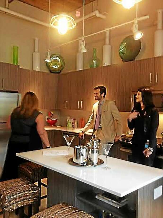The kitchen in the model apartment at Winchester Lofts. Photo: (Mary O'Leary - New Haven Register)