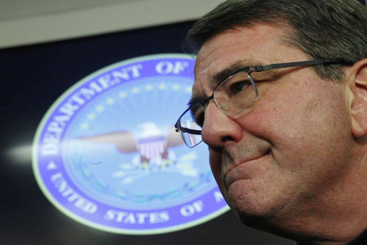 U.S. Secretary of Defense Ashton Carter listens to questions during a press conference on board his plane en route to Afghanistan on Feb. 20, 2015.