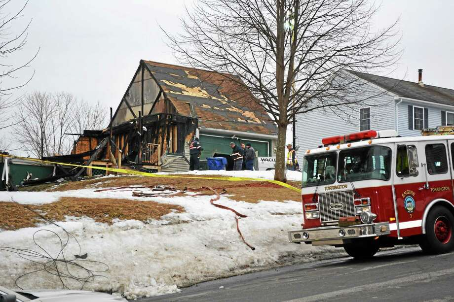Ben Lambert - The Register Citizen  Investigators at the scene of a Highland Avenue fire on Wednesday afternoon in Torrington. Photo: Journal Register Co.