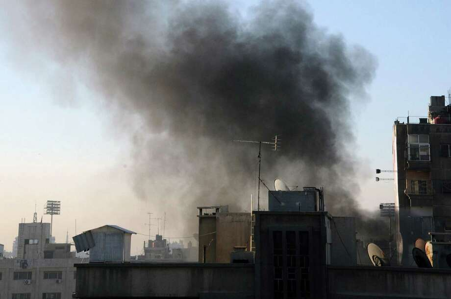 In this photo released by the Syrian official news agency SANA, smoke rises after rebels fired rockets and mortar shells that struck several parts in the capital Damascus, Syria on Feb. 5, 2015. Photo: AP Photo/SANA   / SANA
