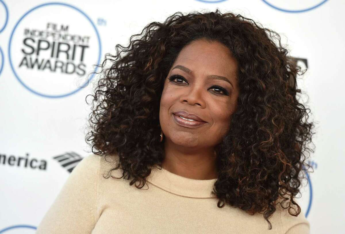 FILE - In this Feb. 21, 2015 file photo, Oprah Winfrey arrives at the 30th Film Independent Spirit Awards in Santa Monica, Calif. Leslie Hindman Auctioneers announced Tuesday, March 24, 2015, that Winfrey will sell paintings, furniture, designer clothing and other items from her Chicago residence at auction next month. The auction house says proceeds will benefit the Oprah Winfrey Leadership Academy for Girls in South Africa. (Photo by Jordan Strauss/Invision/AP)