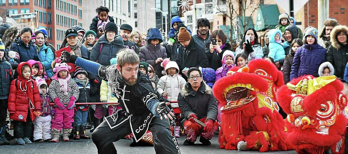 A member of the Yale Wushu Team performs a series of martial art movements on Whitney Avenue in New Haven Saturday at Lunarfest 2015, which is sponsored by the sponsored by the Council on East Asian Studies at Yale University, New Haven Museum and Yale-China Association.