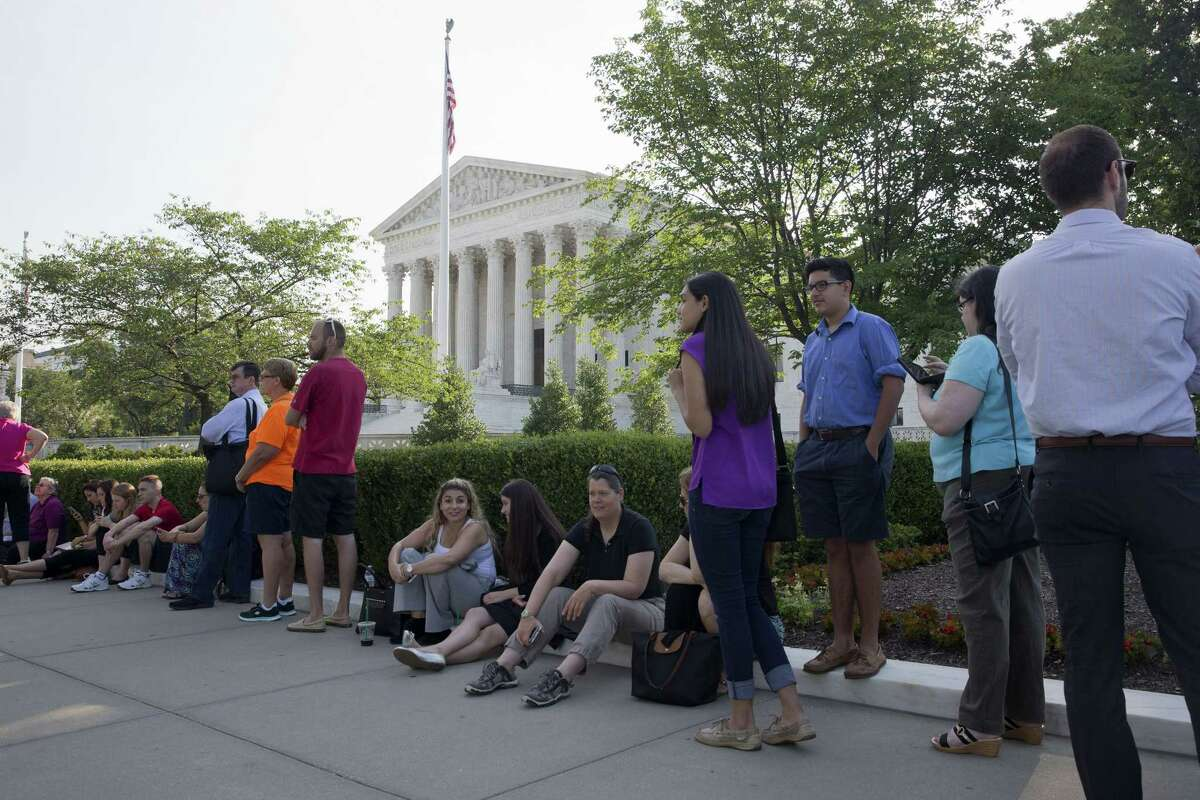 People wait in line to enter the Supreme Court in Washington, Thursday June 25, 2015. The court is expected to hand down decisions today. Two major opinions, health care and gay marriage, are among the remaining to be released before the term ends at the end of June.